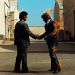"Coperta albumului ""Wish You Were Here"", a trupei Pink Floyd"